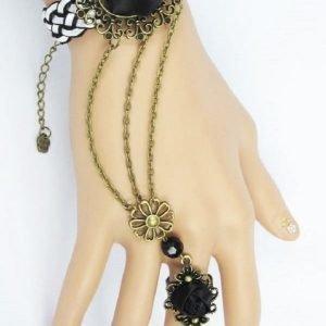 Musta ruusukoristeinen rannekoru/sormusyhdistelmä